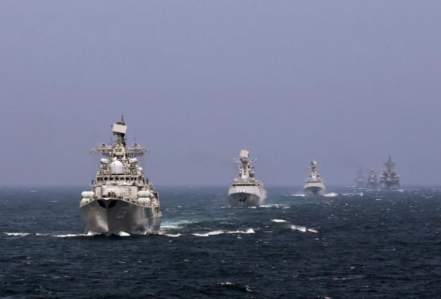 Chinese and Russian naval vessels participate in the Joint Sea-2014 naval drill outside Shanghai on the East China Sea, May 24, 2014. Photo: Reuters/China Daily