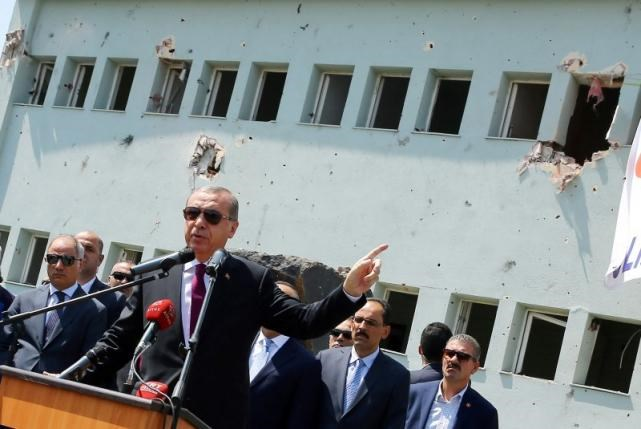 Turkey's President Tayyip Erdogan addresses the audience as he visits the Turkish police special forces base damaged by fighting during a coup attempt in Ankara, Turkey, July 29, 2016. Kayhan Ozer/Courtesy of Presidential Palace/Handout via Reuters