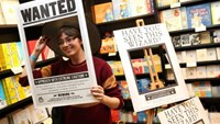 A fan poses for a photograph at an event to mark the release of the book of the play of Harry Potter and the Cursed Child parts One and Two at a bookstore in London, Britain July 30, 2016. Photo: Reuters/Neil Hall