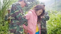 A file photo shows Lo Thi Chom being arrested for human trafficking in the northern province of Lai Chau. Photo: Vietnam News Agency