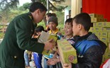 A border guard presents gifts to children in Lao Cai Province's Bat Xat District February 26
