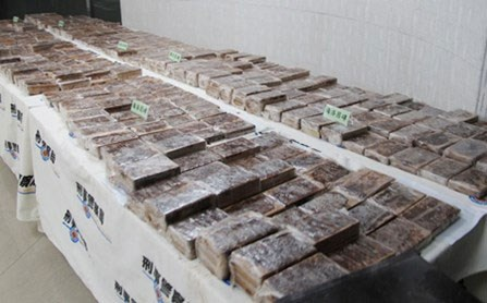 Some of the 600 heroin bricks that were discovered in an aircraft container on display at the Criminal Investigation Bureau building in Taipei Sunday / PHOTO: AFP