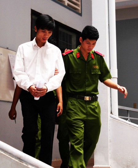Bui Vu Hoang Phuong, 25, of Dong Nai Province being escorted to a courtroom Thursday