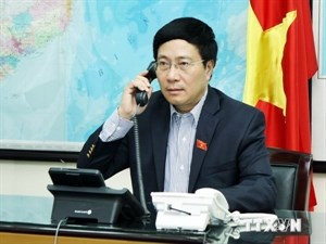 Foreign Minister Pham Binh Minh speaks in a phone call with US Secretary of State John Kerry on May 21. Photo courtesy of Vietnam News Agency