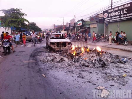 A car set ablaze by rioters in Binh Duong Province near Ho Chi Minh City on May 13. Photo: Do Truong