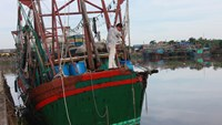 A fishing boat piloted by Nguyen Duc Quang, a fisherman in Hai Phong City, was badly damaged after an attack by a Chinese ship off Vietnam's northern coast on June 6, 2014
