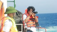 Japanese reporter Yasagai Toshihiro aboard a Vietnam Coast Guard vessel near the Haiyang Shiyou-981 oil rig which China illegally deployed in Vietnamese waters this May. Photo: Hoang Son