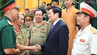 President Truong Tan Sang shakes hands with 80 combat veterans from Division 356 in Hanoi on July 14. Photo credit: Vietnam News Agency