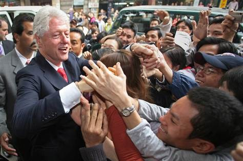 Former US President Bill Clinton is mobbed by well-wishers in Hanoi during his Vietnam visit in 2006. Photo credit: AFP