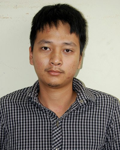 Pham Duy Quy at a police station on August 3. Photo: Viet Hai