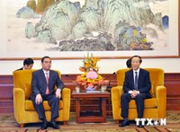 Le Hong Anh (L), the special envoy of Party chief Nguyen Phu Trong, holds a talk with Wang Jiarui, Vice Chairman of the National Committee of the Chinese People's Political Consultative Conference, in Beijing on August 26. Photo credit: Vietnam News Agenc