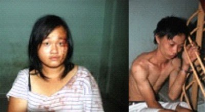 Nguyen Thi Hoang Oanh (L) and Le Thanh Son were arrested on Sunday for robbing an Irish tourist in District 1.
