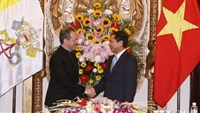 Deputy Foreign Minister Bui Thanh Son (R) shakes hands with Under-Secretary for Relations with States Antoine Camilleri, head of the Vatican delegation in the 5th meeting of a joint Vietnam-Holy See working group, in Hanoi on September 10. Photo credit: V