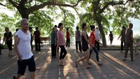 People walk in a public park in Hanoi. Vietnam now has more than 90.4 million people,, the General Statistics Office announced Wednesday. Photo: Ngoc Thang