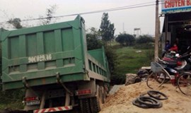 Truck driver arrested after ramming three police cars