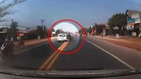 Reckless motorcyclist cheats death in front of high-speed car in Vietnam