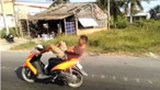 Mekong Delta rider caught steering bike with his feet