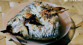 Thai ethnic people and their signature grilled stream fish