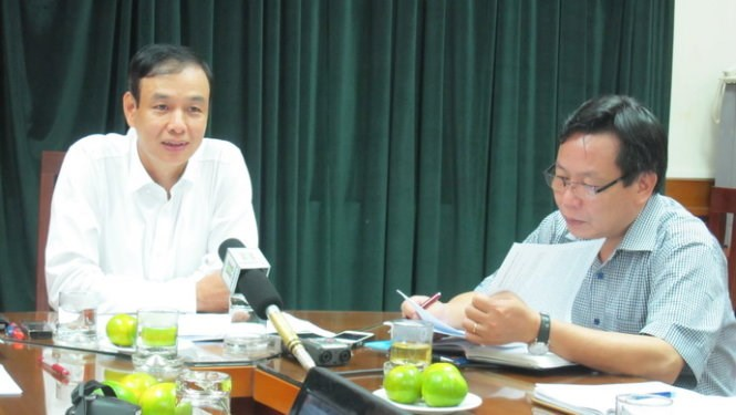 Dao Duc Toan (L), human resources chief of the Hanoi's Party unit, said it is not unusual to see family members working for the same government agency