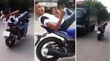 Another Vietnamese filmed lying on motorbike seat, driving with feet