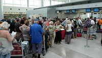 Passengers wait for check-in at Tan Son Nhat International Airport in Ho Chi Minh City. Photo: Bach Duong