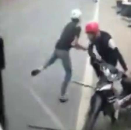 A still from the video shows one of the two suspected dog thieves trying to rob a motorbike.