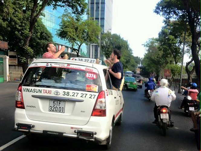 A photo shows the three expats hanging out of the cab's windows to smoke and drink.