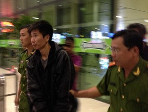 Xue Wen was arrested in Hanoi and then transferred to Ho Chi Minh City for further investigation. Photo provided by the police