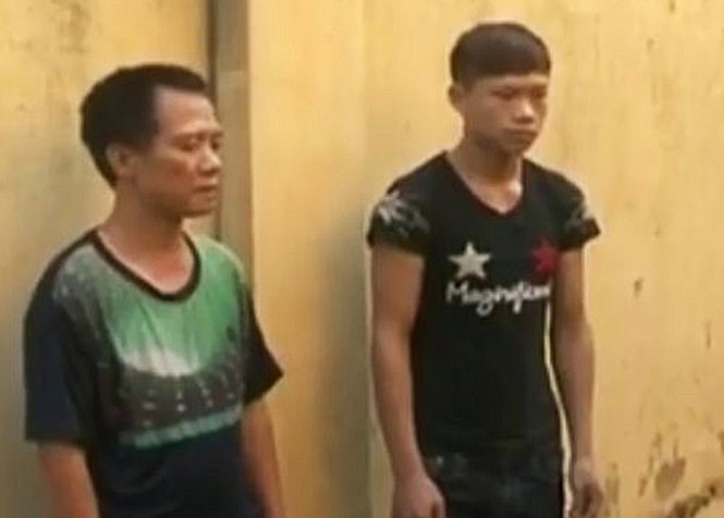 The restaurant owner Nguyen Van Tung (L) and his employee Ly Van Thien in a photo released by police