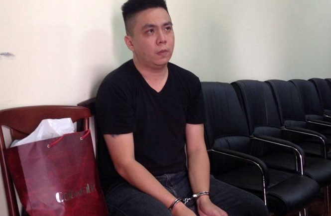 Wong Boon Leong, the alleged Singaporean mastermind behind the gambling gang, at a Ho Chi Minh City police station. Photo: Ngoc Le