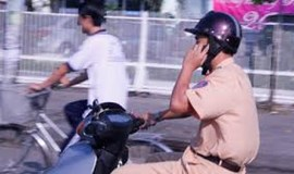 Official calls on locals to film traffic cops violating traffic rules