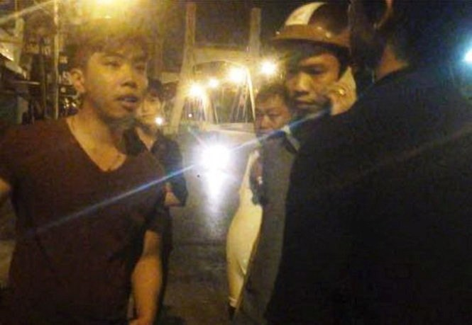 A still from the video clip shows one of the two Binh Thuan policemen in plain clothes