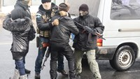 The Security Service of Ukraine officers control a Vietnamese man during a raid on February 28, 2016. Photo credit: Novorossia Today