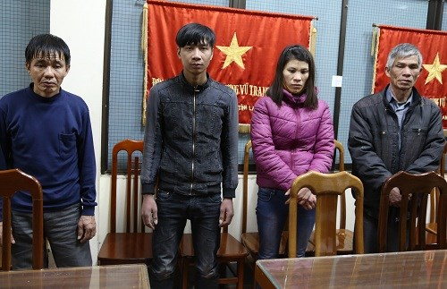 Four members of the gang at a police station in Lang Son. Photo credit: VnExpress