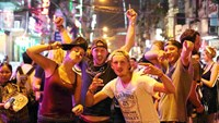 Foreigners celebrate New Year's Eve in Ho Chi Minh City's Pham Ngu Lao Street. Photo: Thanh Nien