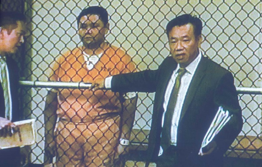Hong Quang Minh appears in court for an arraignment hearing with his attorney, Do Phu, at the jail in Santa Ana on April 15, 2016. Photo credit: The Orange Country Register