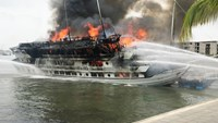 A cruise ship catches fire in Ha Long Bay at around 11 a.m. on May 6, 2016. Photo credit: Quang Ninh newspaper