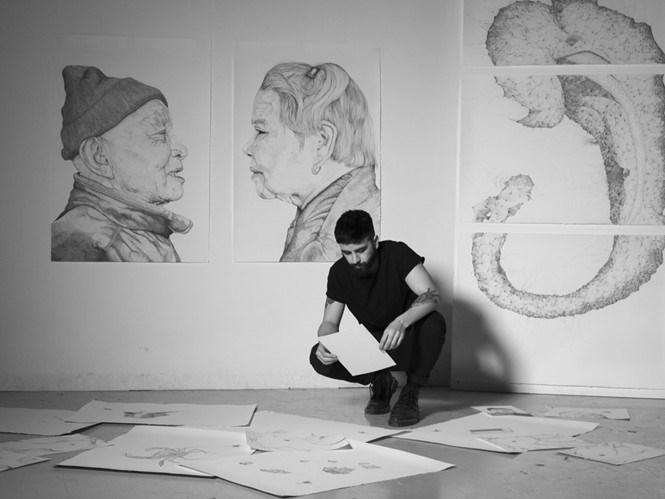 Florian Nguyen and his artworks. Photo provided by the exhibition organizers