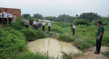 The pond in which three boys allegedly drowned in Dong Nai Province on June 23, 2016. Photo: Le Lam
