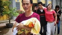 Vietnam minister won't resign despite poor measles guide