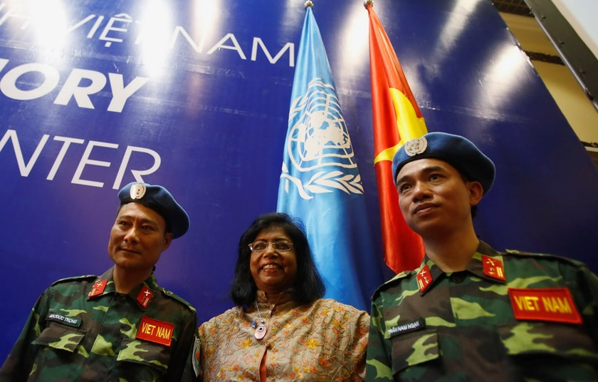 United Nations Deputy Secretary General Ameerah Haq (C) poses for a photo with Vietnamese military officers Lieutenant Colonel Tran Nam Ngan (R) and Lieutenant Colonel Mac Duc Trong after the inauguration ceremony of Vietnam's Peacekeeping Center in Hanoi