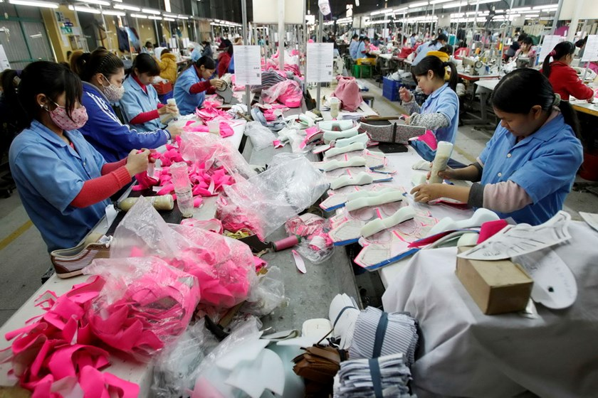 Employees work at a shoe factory in Tan Lap village outside Hanoi. Photo credit: Reuters
