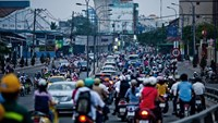 Traffic moves along in downtown Ho Chi Minh City. Photo credit: Bloomberg