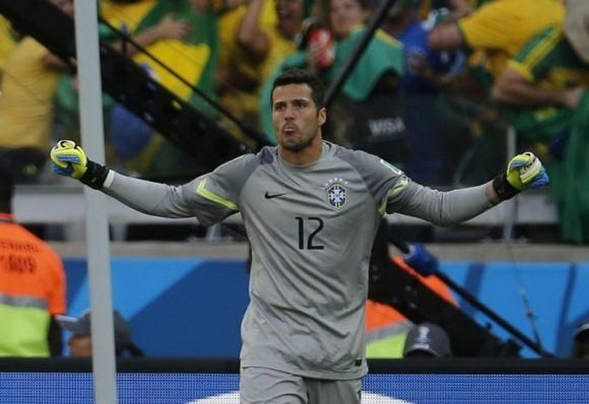 Brazil's goalkeeper Julio Cesar celebrates after the penalty shootout at the 2014 World Cup round of 16 game between Brazil and Chile at the Mineirao stadium in Belo Horizonte June 28, 2014. Photo credit: Reuters