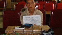 Lao national Xong Ba Tu is arrested in Vietnam's Nghe An Province for trafficking 3.7 kilograms of heroin on June 28, 2014. Photo credit: Lao Dong