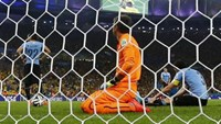Uruguay's goalkeeper Fernando Muslera (C) and his teammates react after Colombia's James Rodriguez (not pictured) scored a second goal during their 2014 World Cup round of 16 game at the Maracana stadium in Rio de Janeiro June 28, 2014. Photo credit: Reut