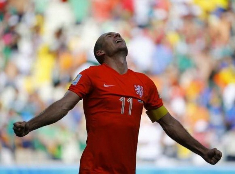 Arjen Robben of the Netherlands celebrates after winning their 2014 World Cup round of 16 game against Mexico at the Castelao arena in Fortaleza June 29, 2014. Photo credit: Reuters