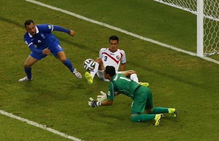 Costa Rica's Keilor Navas (front) makes a save in front of teammate Giancarlo Gonzalez (3) and Greece's Konstantinos Mitroglou during their 2014 World Cup round of 16 game at the Pernambuco arena in Recife June 29, 2014. Photo credit: Reuters