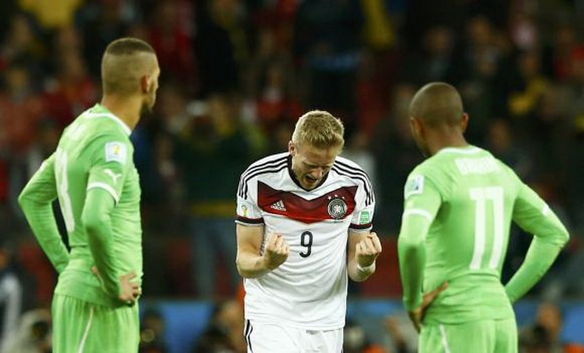 Germany's Andre Schuerrle (C) celebrates scoring a goal during extra time in their 2014 World Cup round of 16 game against Algeria at the Beira Rio stadium in Porto Alegre June 30, 2014. Photo credit: Reuters