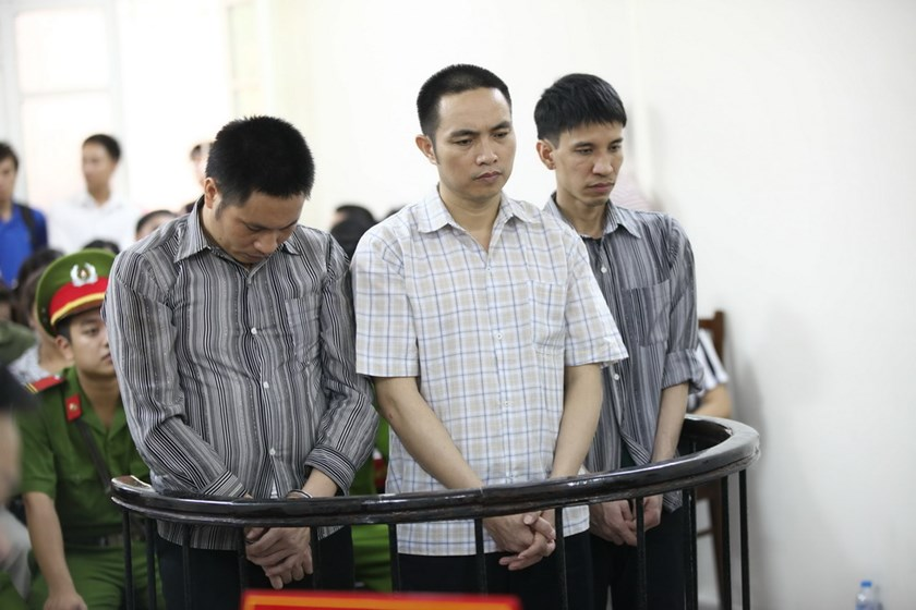 Three managers of a fraudulent online shopping site stand at a trial in Hanoi June 30, 2014. Photo credit: Reuters